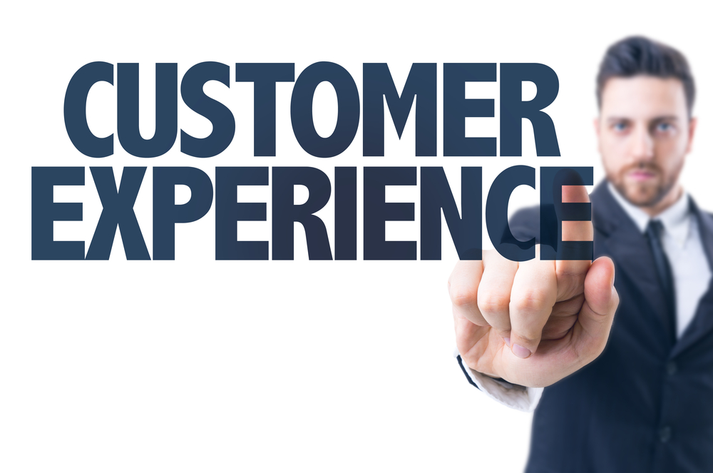 Business man pointing the text Customer Experience